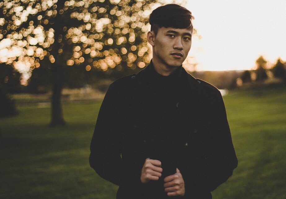 handsome asian gay posing and looking serious into the camera