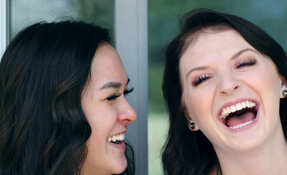 happy bi couple laughing