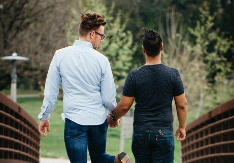 gay couple holding hands and taking a walk