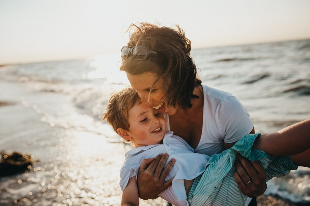 attractive single mum with kid on the beach