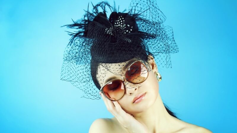 attractive widow with sunglasses and hat waiting for new love