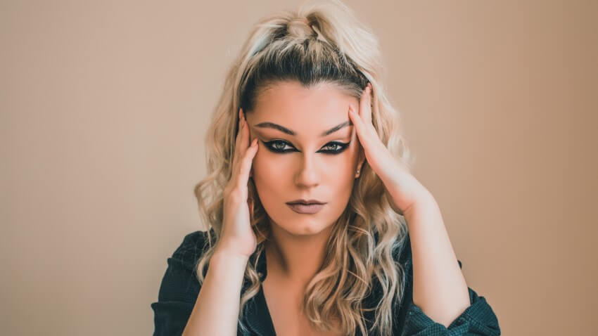 stunning trans woman with smokey eyes staring into the camera