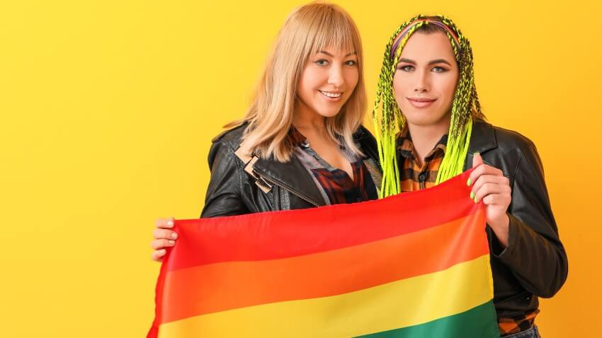 transgender women holding up lgbt pride flag