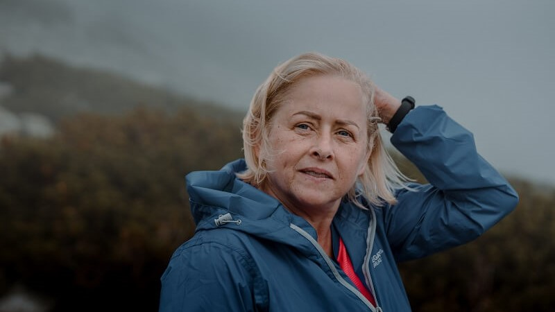Blonde granny on a romantic hike