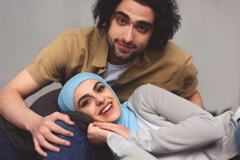 muslim girl lies on boyfriend's lap