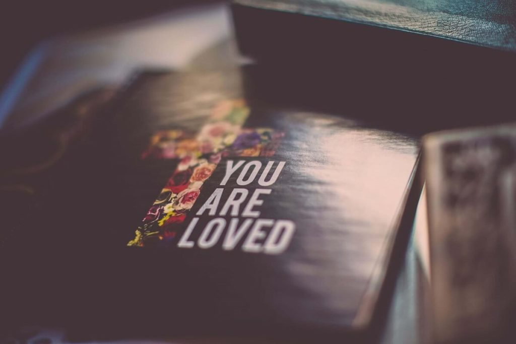 """Religious Christian book that says """"You are loved"""""""