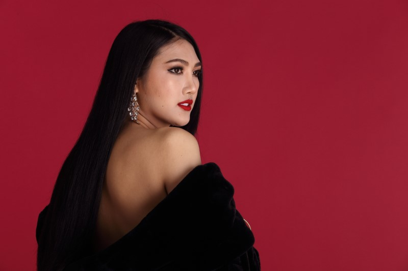 asian trans woman wearing elegant coat