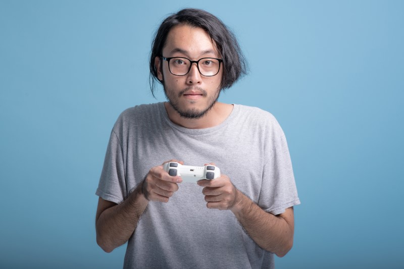 stereotypical Asian man who plays console games