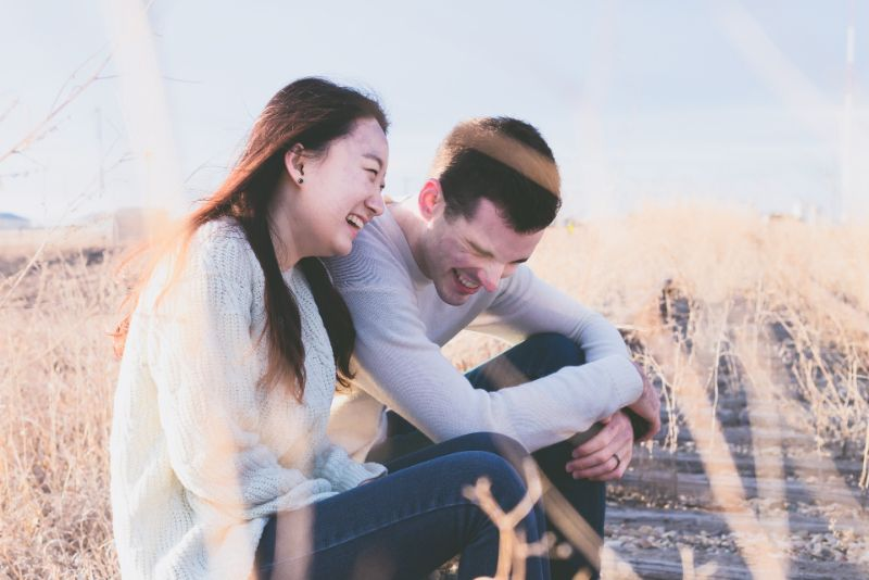 Laughing Christian couple sitting