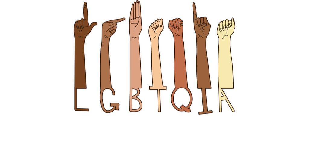 hands showing LGBTQIA letters