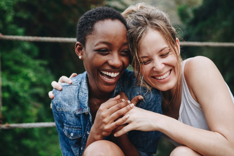 women in love laughing