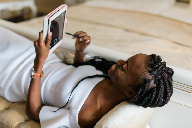 woman on her tablet dating online