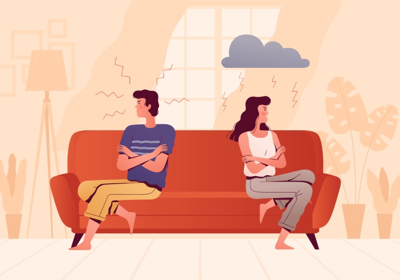 couple fighting on their couch